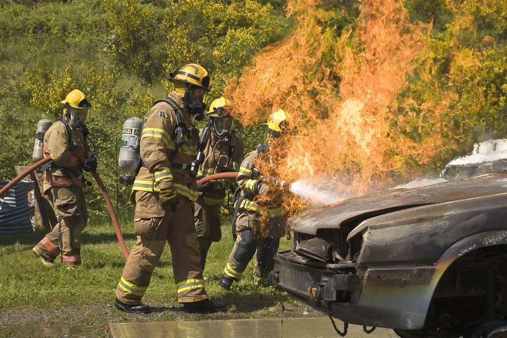 fire fighters fighting car fire